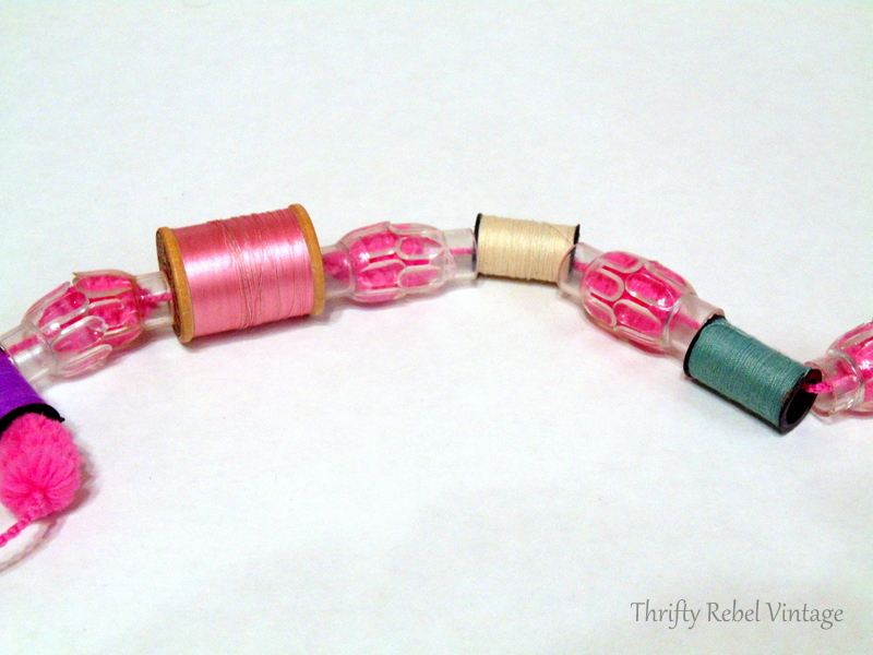 thread spool and light reflector puff ball yarn garland
