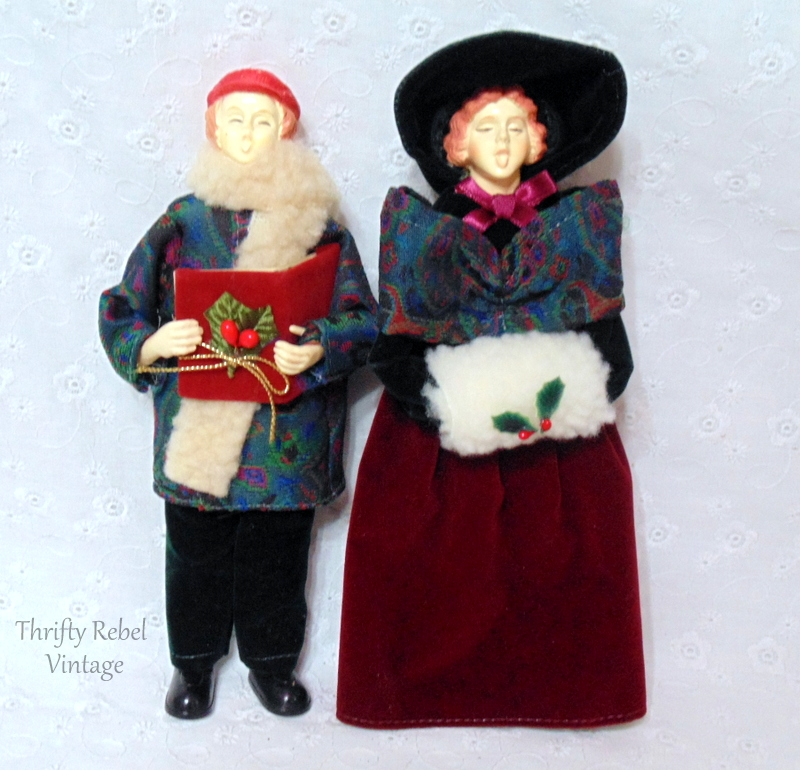 vintage boy and girl carollers dressed in period clothing