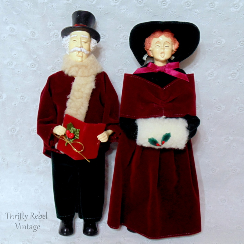 vintage man and woman carollers dressed in period clothing