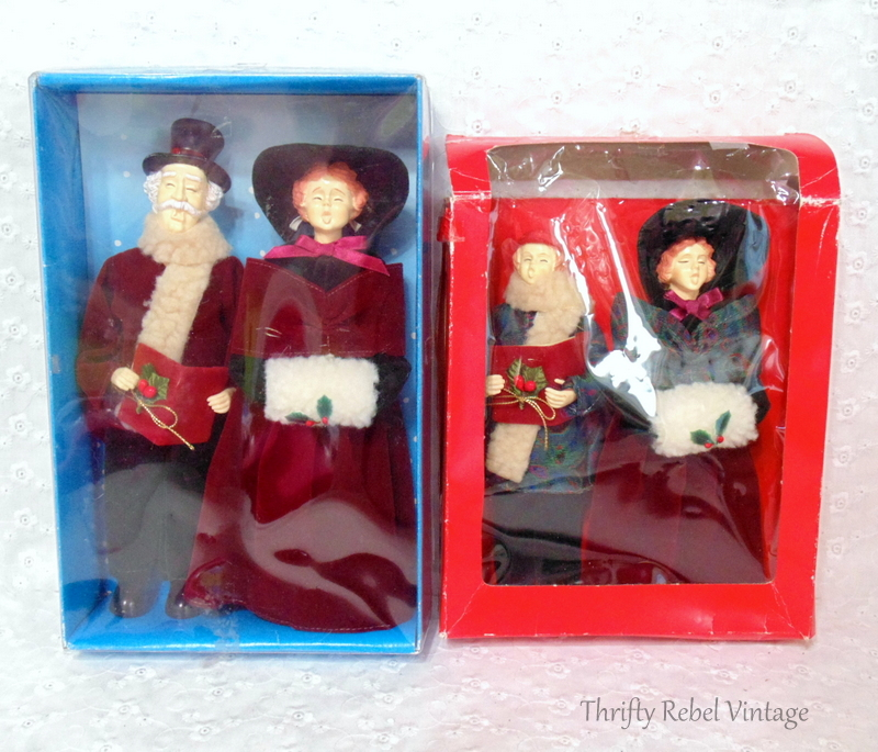 vintage man, woman, boy and girl carollers dressed in period clothing in boxes