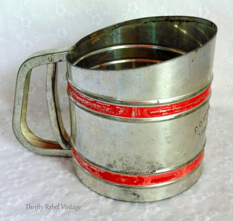 side view of vintage metal power sifter flower sifter 2