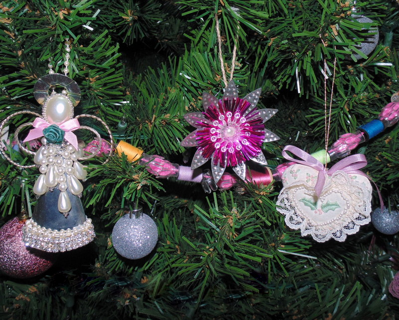 Flower ornament made from repurposed vintage light reflectors on Christmas tree