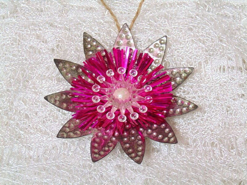 Flower ornament made from repurposed vintage metal and plastic light reflectors