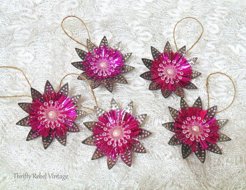 Flower ornaments made from repurposed metal and plastic Christmas tree light reflector