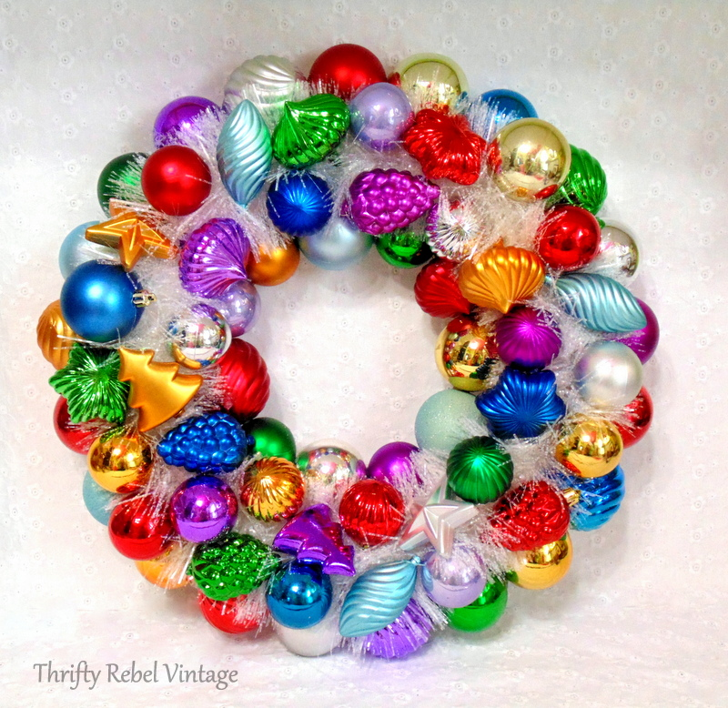 Multi-colored Christmas ornament wreath with white sparkly garland