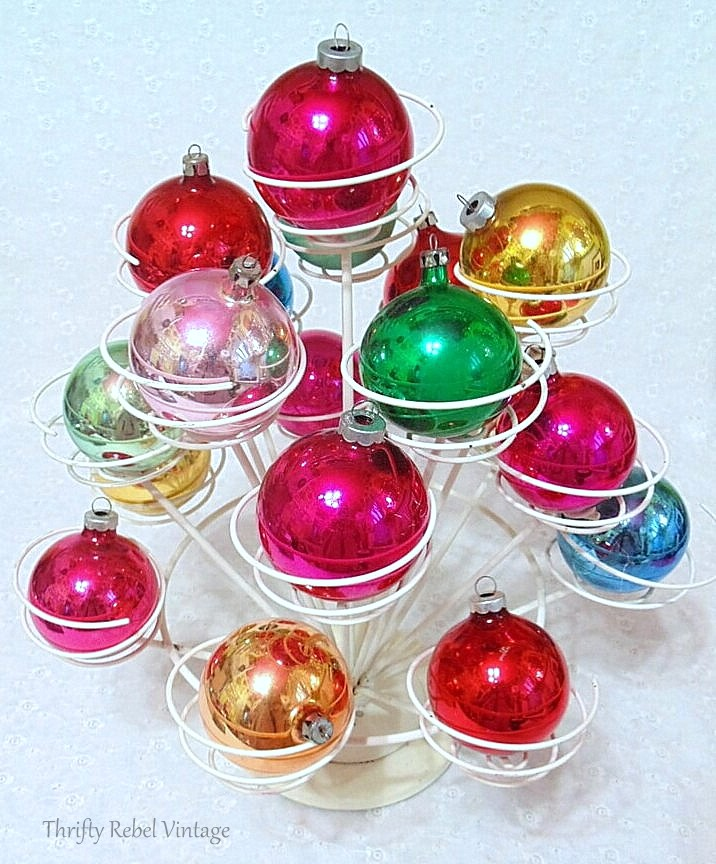 Repurposed cupcake holder used to display of vintage glass ornaments 1