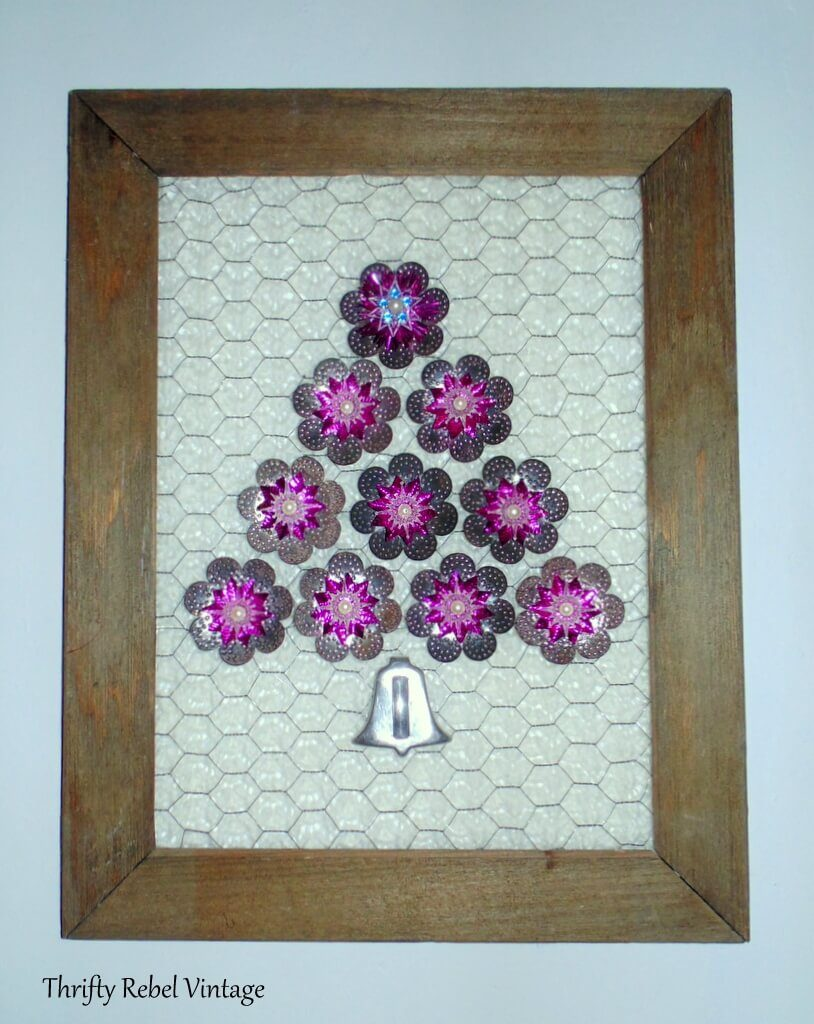 Vintage tree light reflectors repurposed as wall art Christmas tree on barnboard and chicken wire frame 2