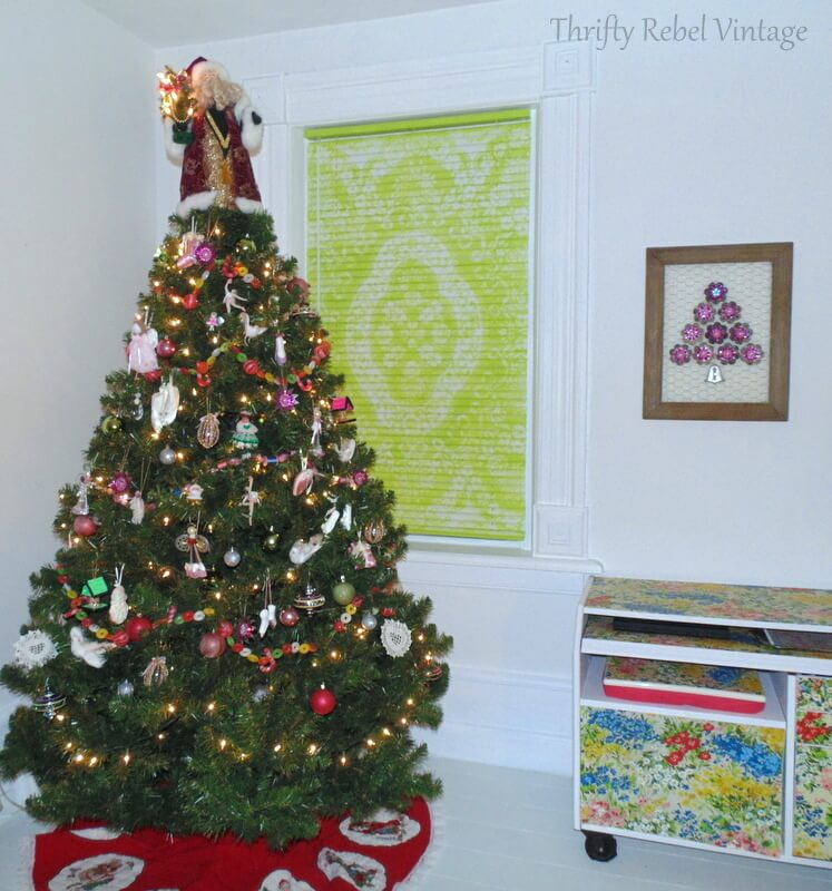 Vintage tree light reflectors repurposed as wall art Christmas tree on barnboard and chicken wire frame in living room
