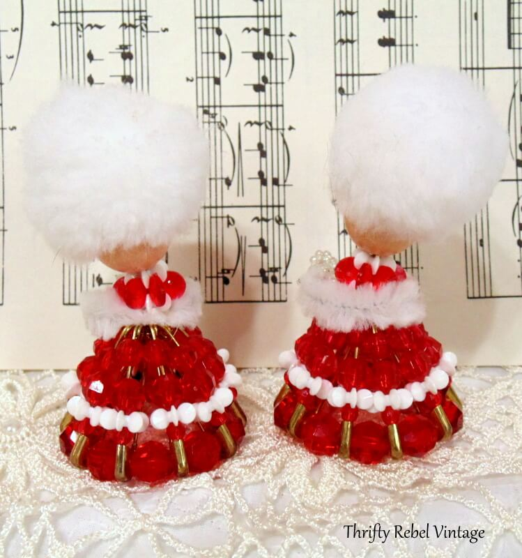 back of vintage beaded lady ornaments with red and white dresses