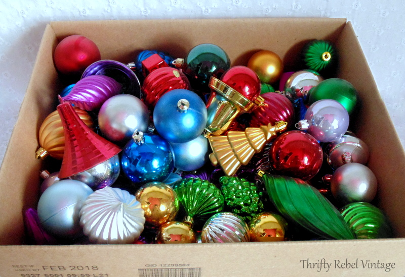 box of mixed plastic ornaments for Christmas Ornament wreath