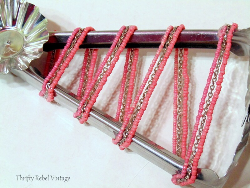 metal salad tongs wrapped with beaded necklace for repurposed Christmas tree