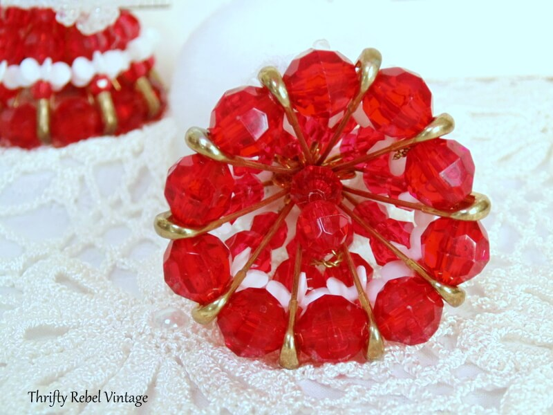 view inside safety pin dress of vintage beaded lady ornaments