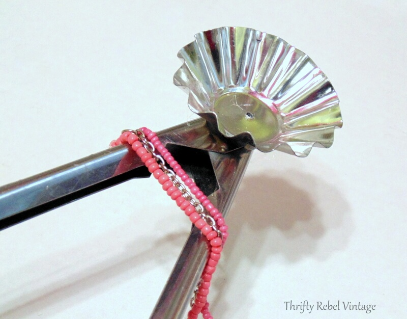 wrapping and gluing necklace around salad tongs for diy Christmas tree