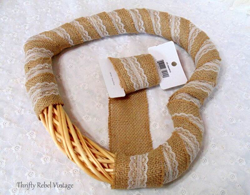 wrapping burlap ribbon around wicker heart wreath form