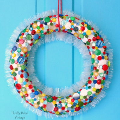 How to make a colorful diy button wreath with white garland back