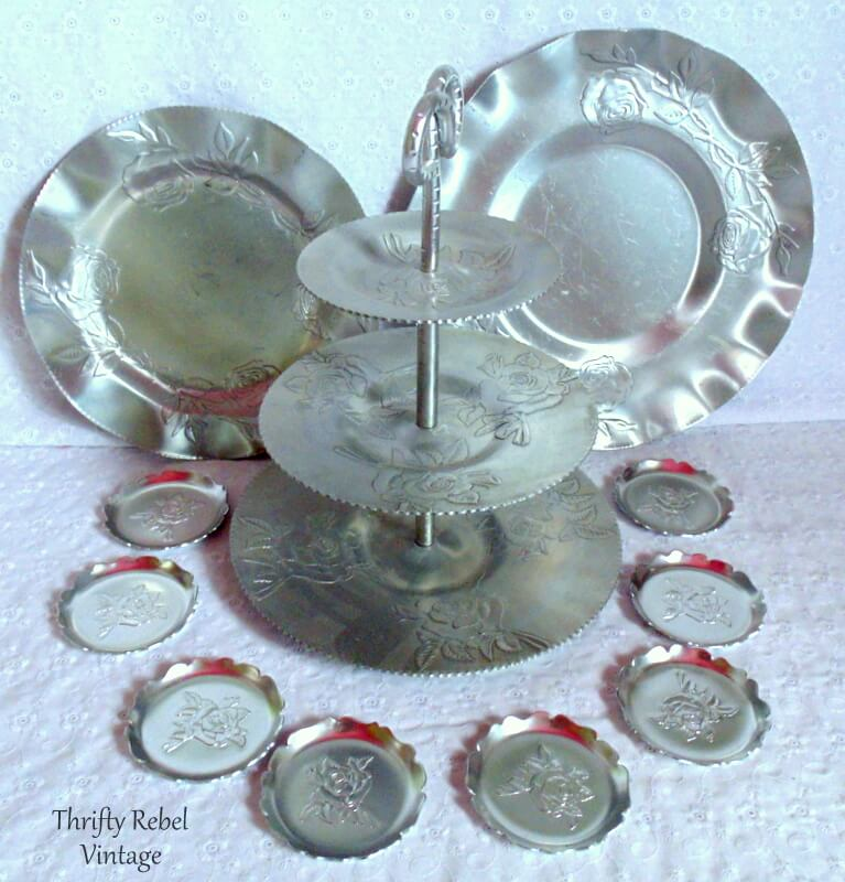 Vintage aluminum roses tiered stand, 2 trays, and 7 coasters