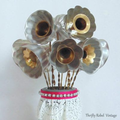 close up of repurposed jello mold flowers bouquet with candle snuffler stems
