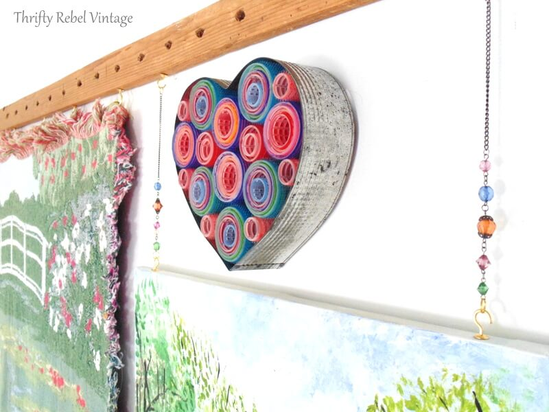 coming down the stair view of curlers and vintage heart shaped baking frame wreath