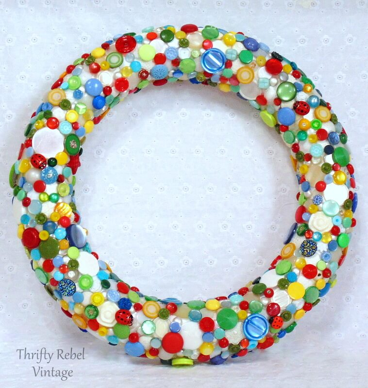 finished diy button wreath with white cream red blue yellow and green butons