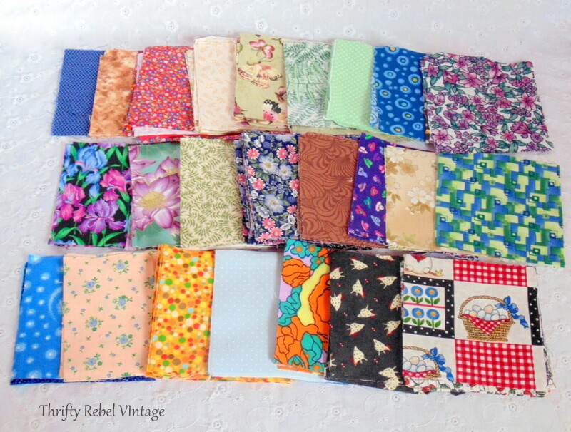 thrifted lot of 4 inch quilting squares pile 2