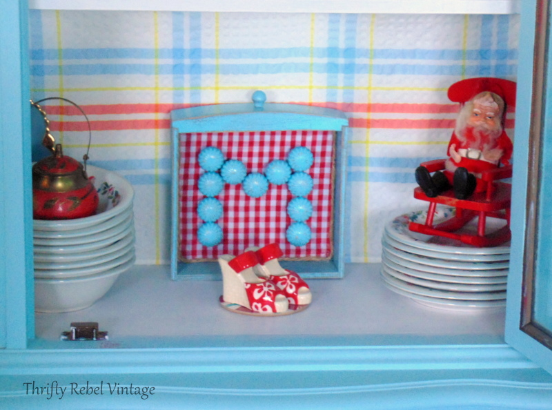 Repurposed drawer monogram sign using spray painted brass knobs and red and white checked fabric 2