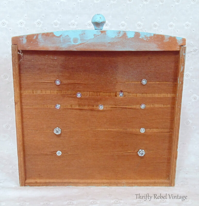 back view of repurposed drawer monogram sign used knobs as the letter M
