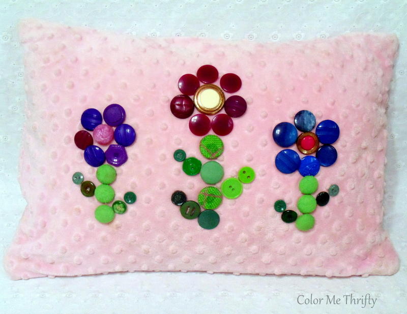 Pink pillow makeover with button flowers