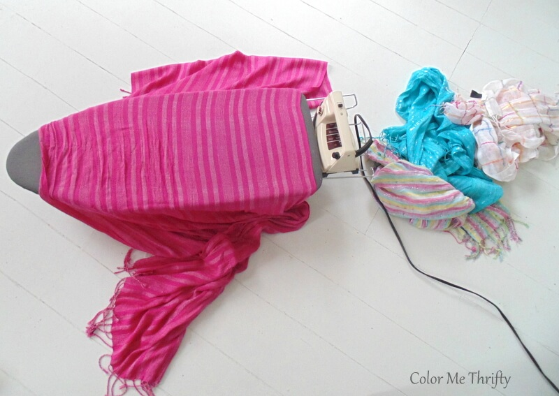 ironing scarves before cutting and making into scarf curtains