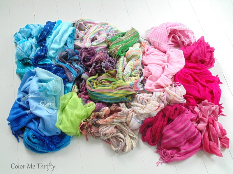 pile of scarves being used for scarf curtains