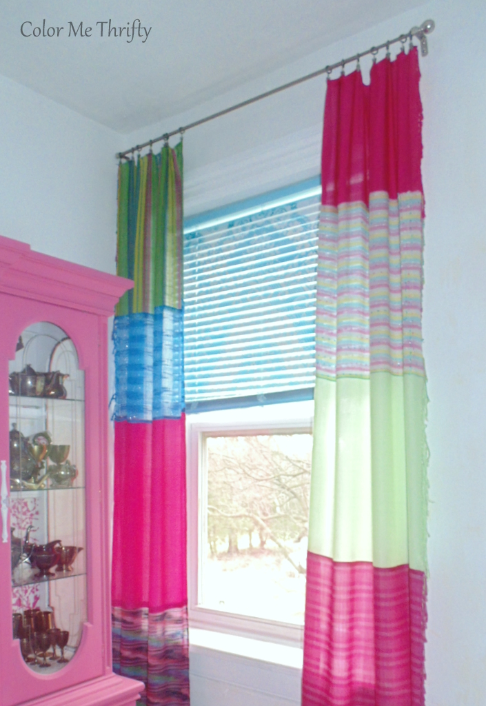 repurposed no sew curtains from scarves hanging in living room window