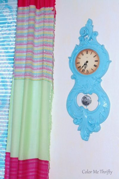vintage Syroco clock makeover with spray paint and decoupaged pendulum