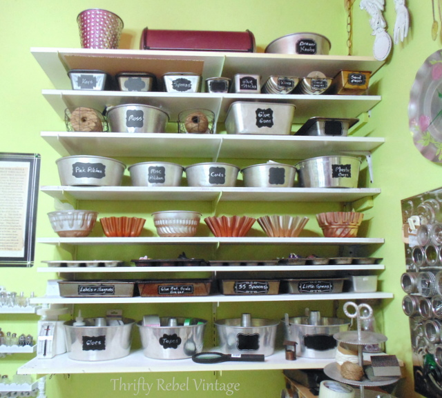 Repurposed baking pans used as craft room storage