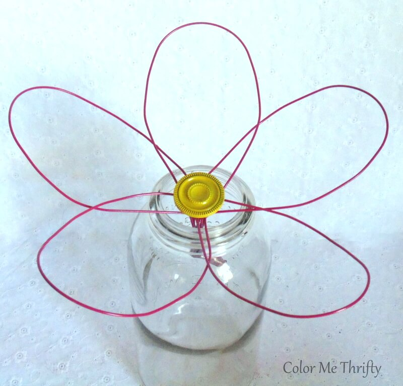 glued drawer knob into center of whisk flower and let it cure in jar