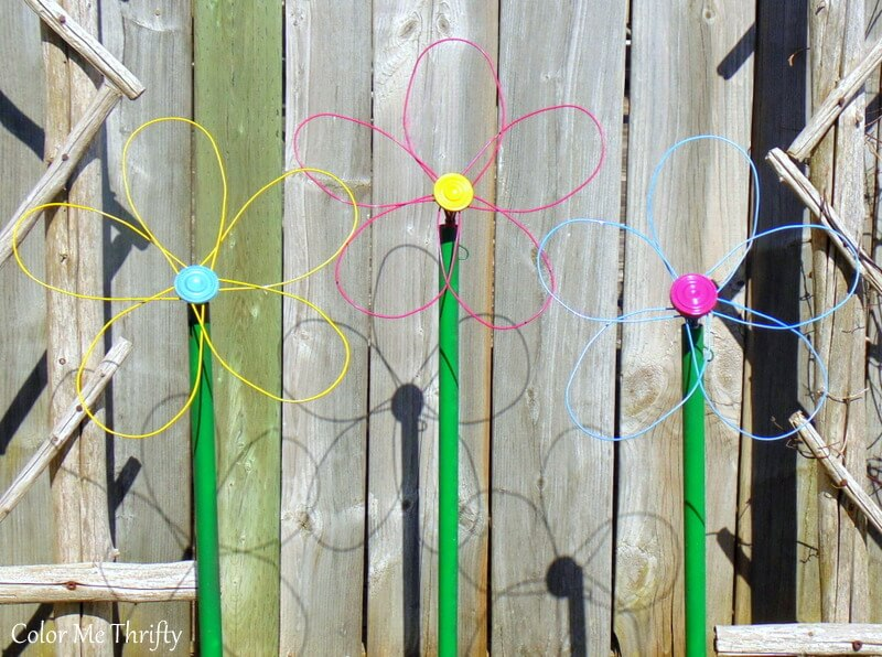 pink blue and yellow diy repurposed whisk flowers for the garden