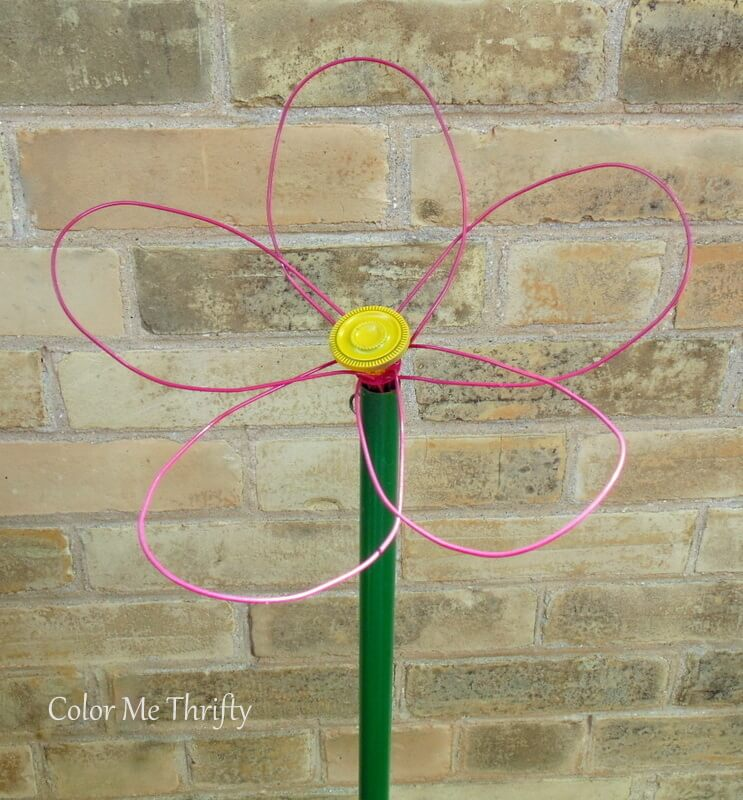 pink repurposed whisk flower with drawer knob center