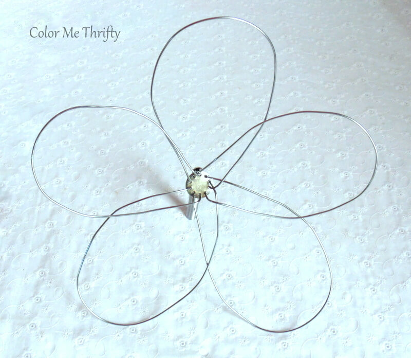 pouffing metal whisk parts to create flower petals