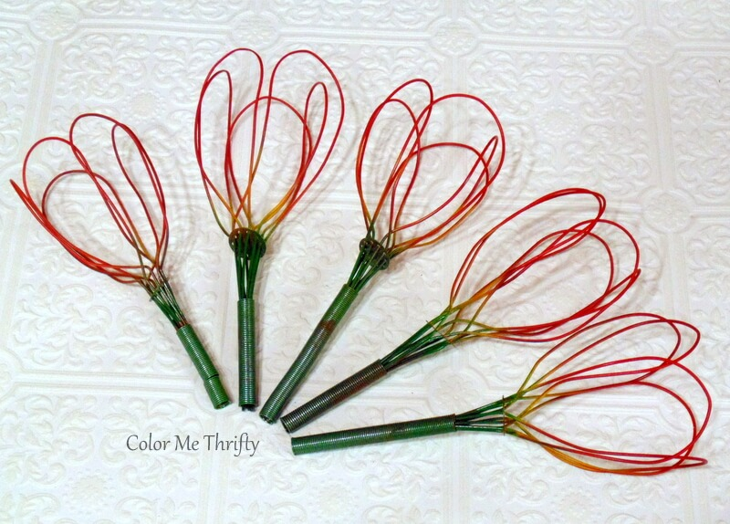 repurposed metal whisk tulips spray painted red and yellow and green