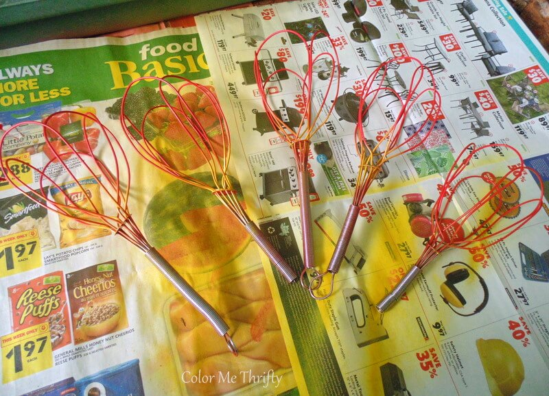 repurposed whisk tulips spray painted red and yellow