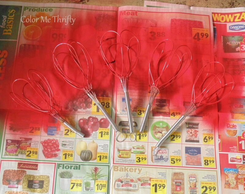 spray painting metal whisk red