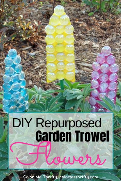 repurposed garden art trowel flowers