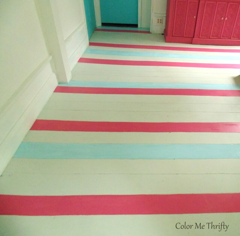 adding blue painted stripes onto living room wooden floor