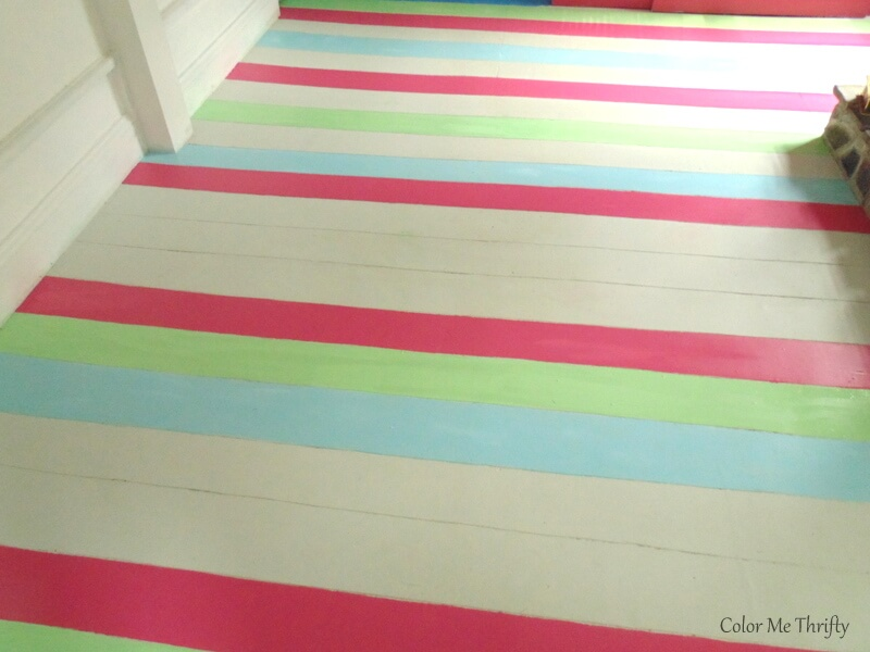 adding green painted stripes onto living room plywood floor