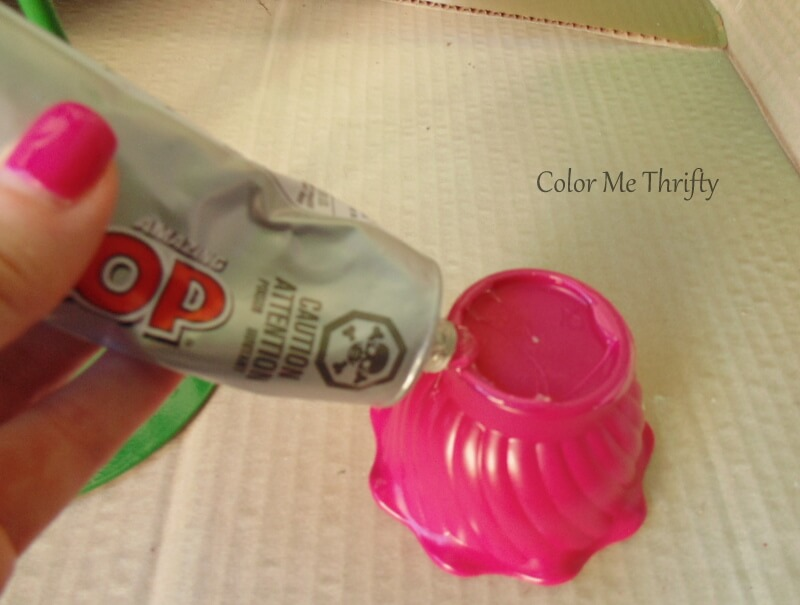 applying marine goop adhesive to bottom of spray painted jello mold