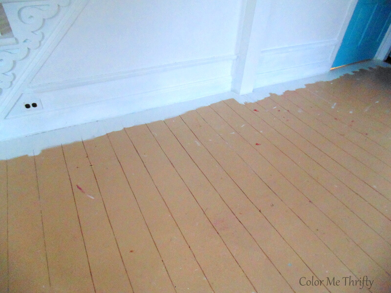 cutting in with paint around the perimeter of the living room floor