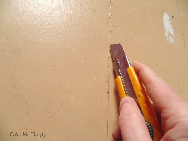 cutting into plywood floor using xacto knife
