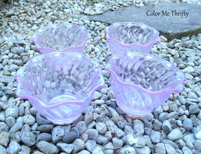four pink flower shaped jello molds