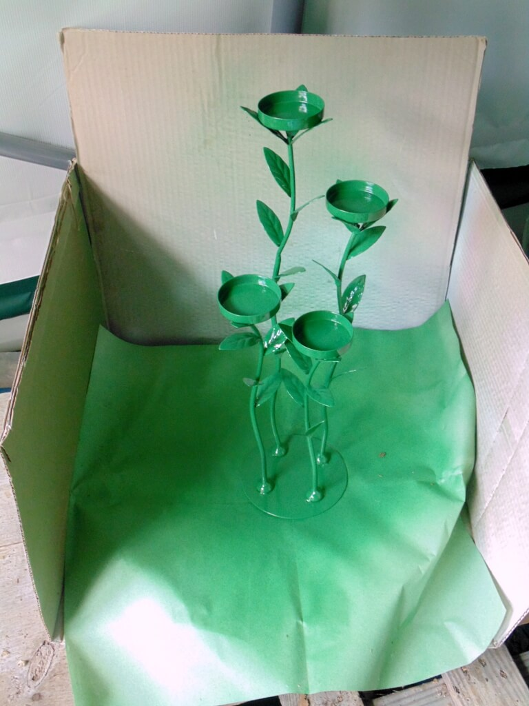 spray painting wrought iron candle holder green
