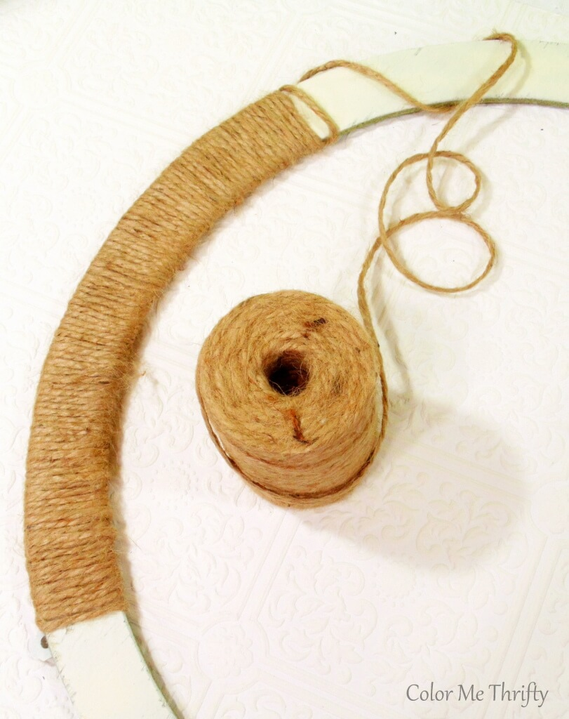 wrapping jute twine around round wooden frame