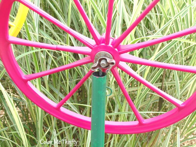 back view of doll carriage wheel flower in pipe stem