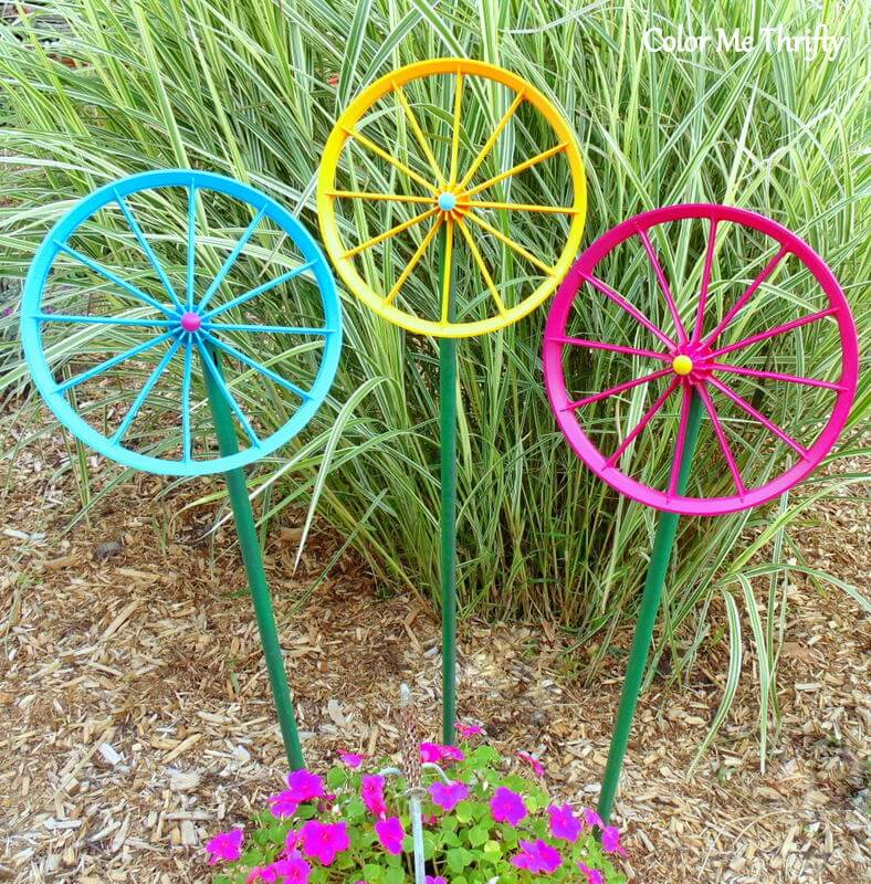 diy repurposed wheel flowers in garden